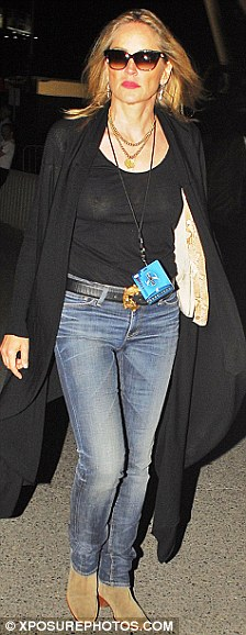 See-through: Sharon Stone's sheer top reveals she has no bra on underneath