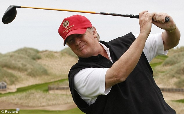 Swing when you're winning: Donald Trump practices his swing at the 13th tee of his new golf course on the Menie Estate near Aberdeen