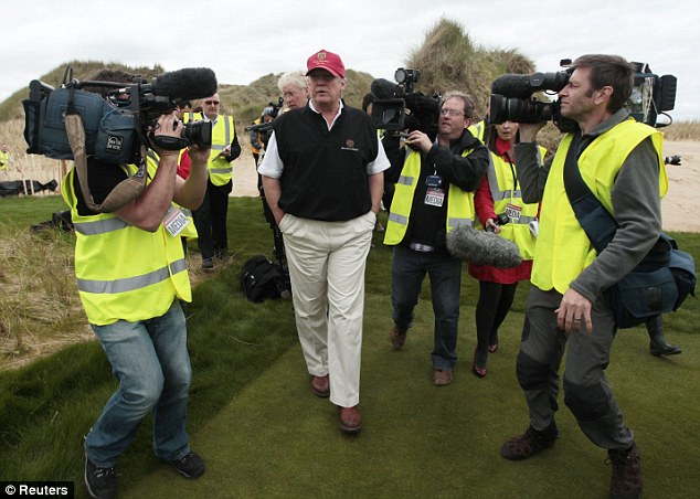 Spotlight: The tycoon toured the first completed holes under the watchful eye of the media