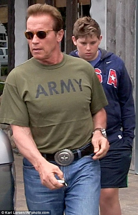 Sombre: Arnold Schwarzenegger looked downbeat today as he spent his first Father's Day since splitting from wife Maria Shriver, with his youngest son