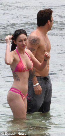 Fun in the sun: Megan and Brian didn't seem to have a care in the world as they enjoyed their Hawaiian holiday
