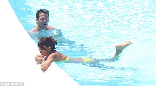 So cool: The footballer and his female companion let the water work its magic