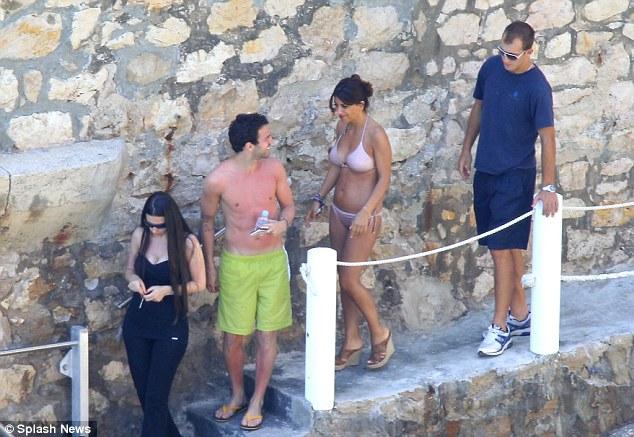 Here we go: Cecs, his sister Carlota and 'Daniela' head down to their waiting boat