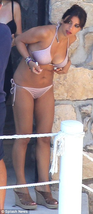 All change: Carla sported a different bikini as the couple headed out to sea for a jet ski ride