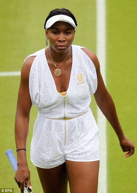 Tiny playsuit: Venus Williams wore a thigh-skinning playsuit - with a curiously baggy top half for her first Wimbledon game today