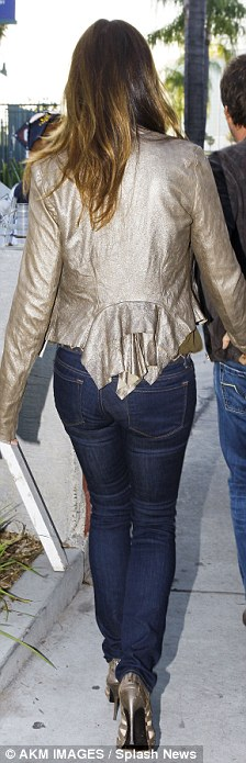 Stylish: Cindy looked chic in a gold jacket and tight jeans