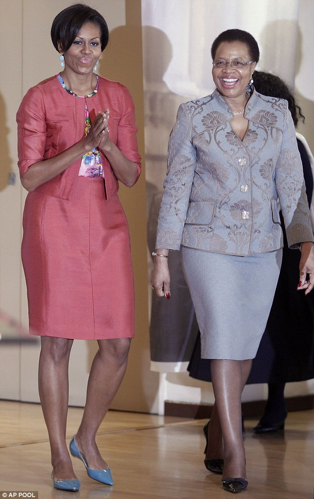 Special surprise: Michelle Obama had been scheduled to meet with Nelson Mandela's wife Graca Machel