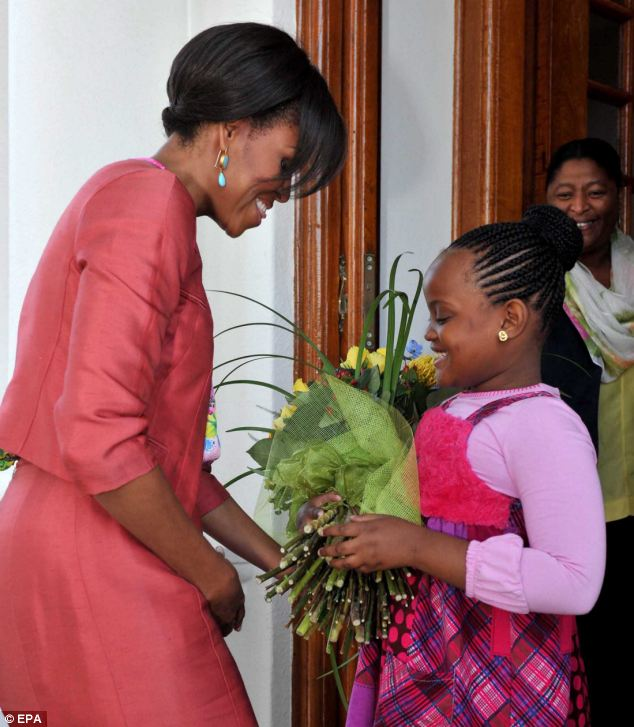 Gift: The First Lady receives flowers as she arrives at Mahlamba Ndlopfu in Pretoria