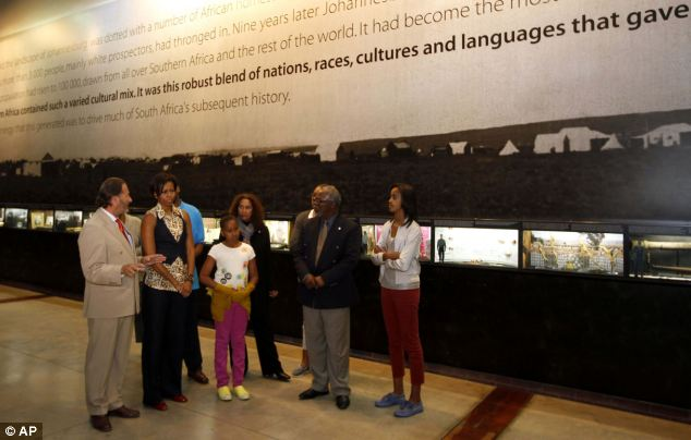 Tour: Michelle Obama, along with daughters Sasha and Malia, visit the Apartheid Museum in Johannesburg