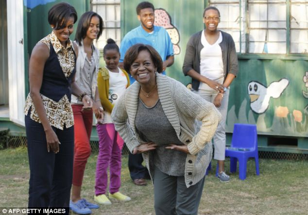 Applause: Marian Robinson, mother of the First Lady, takes a bow after they danced with children during a visit to the Emthonjeni Community Center in Zandspruit Township