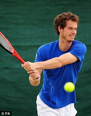 Andy Murray gets in some practice as the rain starts to fall ahead of his second round match today