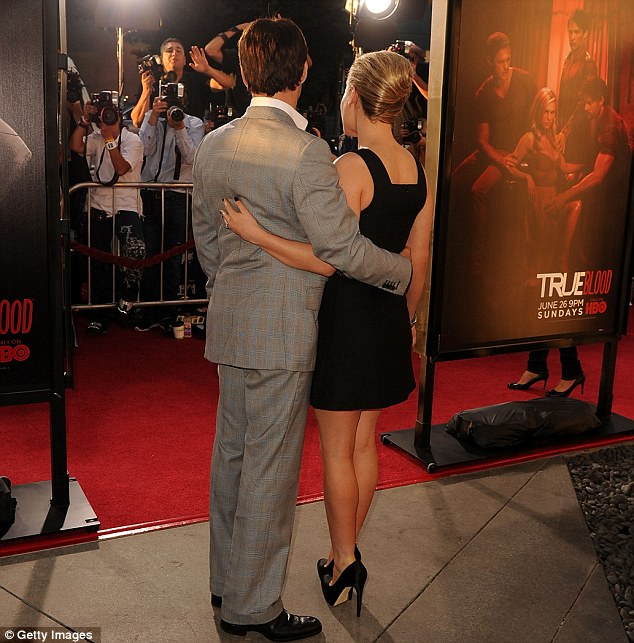 Flash happy: Anna Paquin and Stephen Moyer stood arm in arm for the photographers outside the cinema