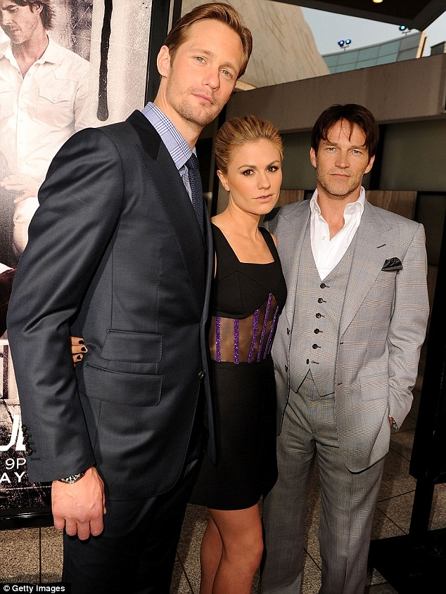 Co-stars: True Blood stars Alexander Skarsgard, Anna Paquin and Stephen Moyer pose on the red carpet at their series' season 4 premiere