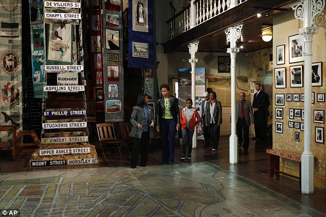 History: First Lady Michelle Obama visits the District Six museum in Cape Town, South Africa, with her daughters