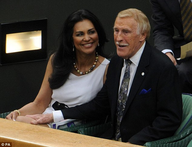 Tender: Sir Bruce Forsyth rests his hand his wife Wilnelia's thigh as they settle down in the Royal Box on Centre Court