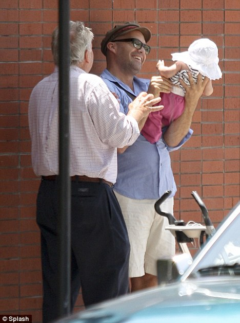 Apple of his eye: Billy Zane coos over his young daughter with a friend outside the Kings Road Cafe in West Hollywood