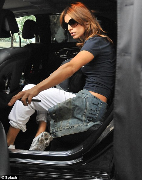 On her way: The Italian actress was chauffeured to the airport in a large black vehicle