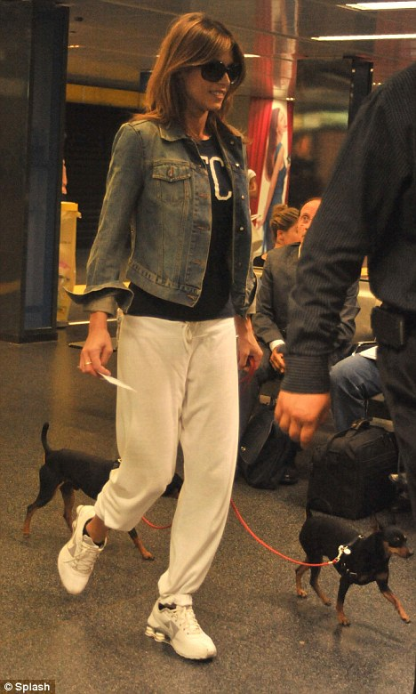 A girl's best friend: Newly single Elisabetta Canalis was spotted strolling through Milan's Malpensa Airport today with her two dogs