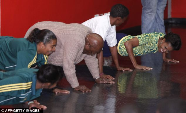 Push it: The mother-of-two and the 79-year-old showed off their strength as they did push ups on the floor