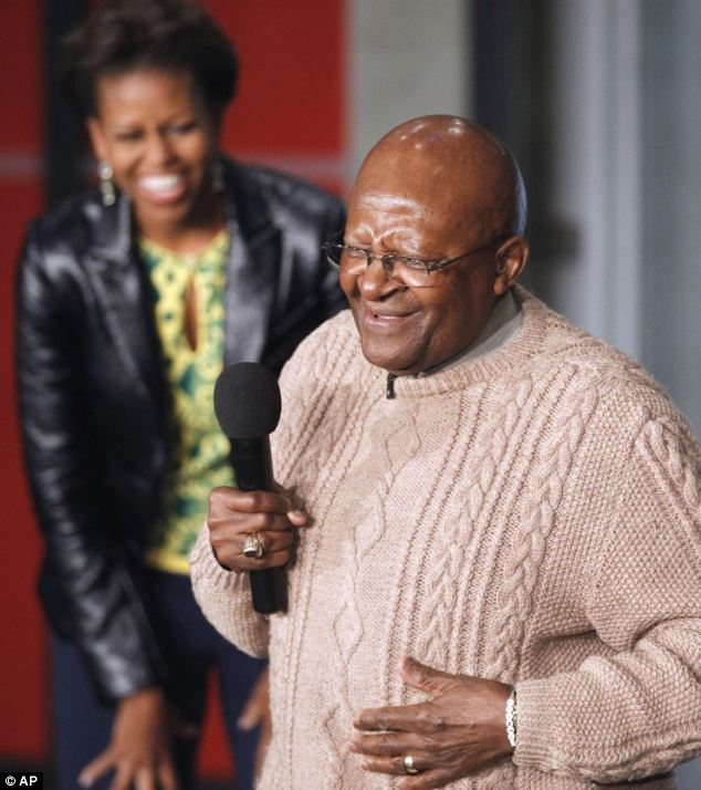 Sharing a joke: Archbishop Desmond Tutu speak to youths before taking part in activities raising awareness for HIV prevention