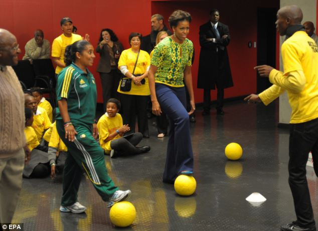Ball skills: Mrs Obama appeared eager to see how they promote exercise on the other side of the world