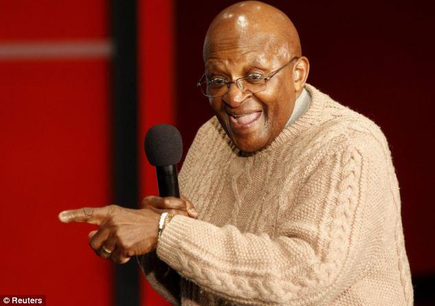 Joker: Archbishop Desmond Tutu talks to children during a visit to Cape Town