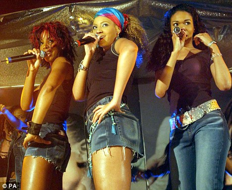 Global success: Destiny's Child as they were in 2002 - the trio have achieved varying levels of success since their split in 2005