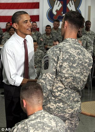 President Barack Obama visits with soldiers from the 10th Mountain Division