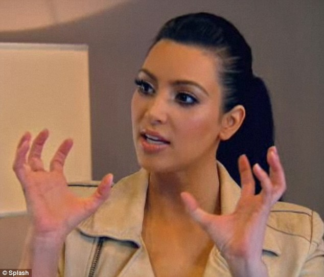 Candid: Kim makes gestures as she describes the controversy surrounding her backside