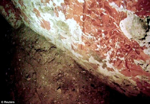 Intact: The footage revealed a funeral chamber with red frescoes, pottery and pieces of a funerary shroud made of jade and mother of pearl
