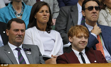 Famous friends: Rupert sitting with All England Lawn Tennis Club Chairman Philip Brook