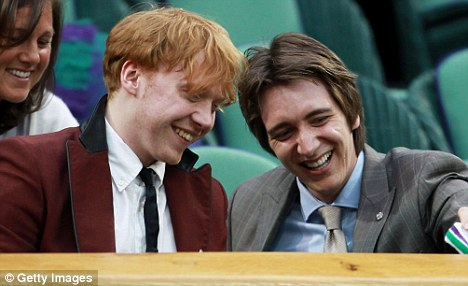 Enjoying themselves: Rupert was with fellow Harry Potter star Oliver Phelps, who plays his on-screen brother George in the films