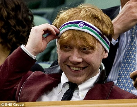 Giggles all round: Rupert laughs as he tried on a Wimbledon headband