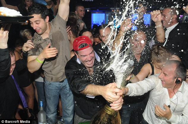 Careful, don't spill it: Businessman and gambler Don Johnson spray revellers with £120,000 champagne bought from the One For One nightclub in Park Lane, London, over the weekend