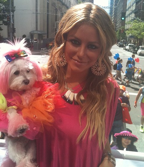 Support: Aubrey O'Day and her dog, Ginger, showed their colours in San Francisco