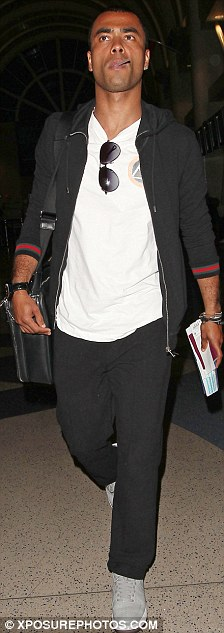 Superfly guy: Ashley Cole, seen here flying from Los Angeles to New York on Sunday, met with Jay-Z today - seen in London on Monday, at the star's Roc Nation offices in Manhattan