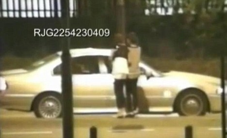 Cruising the streets: Police surveillance footage shows Mohammed Liaqat and Abid Mohammed Saddique in their BMW speaking to girls in Derby