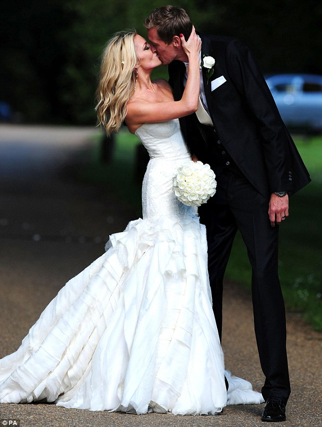 Kiss me quick: The Scouse model grabs her new husband for a passionate kiss after their nuptials