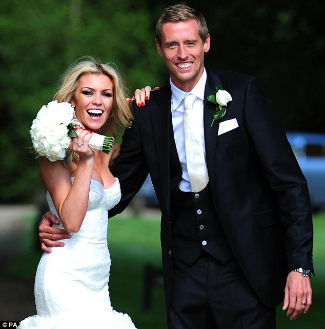 Ready to party: The couple can't stop smiling following their ceremony at the Church of St Mary Magdalene