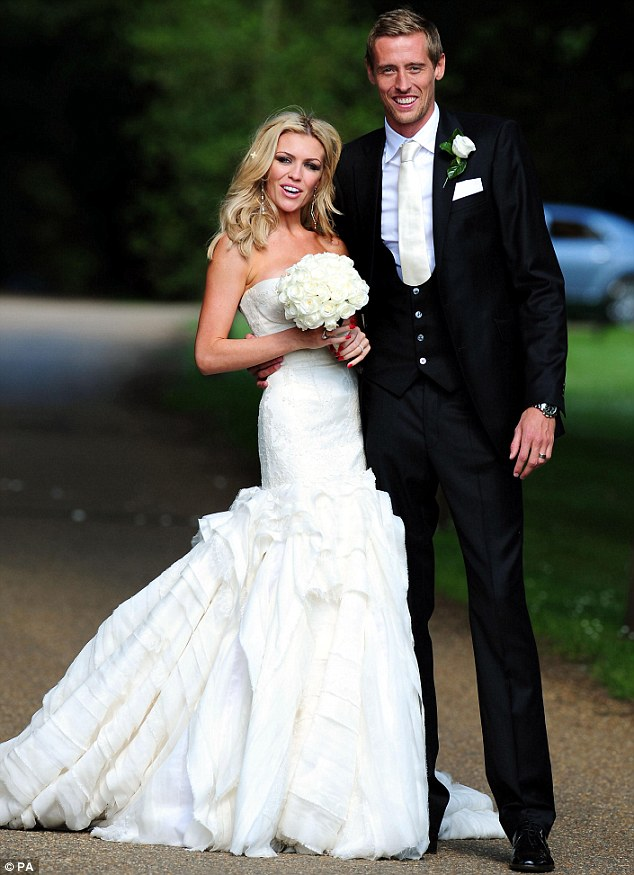 Presenting Mr and Mrs Crouch: Stunning bride Abbey Clancy and her new husband Peter Crouch pose after their marriage ceremony in Stapleford Park in Leicester