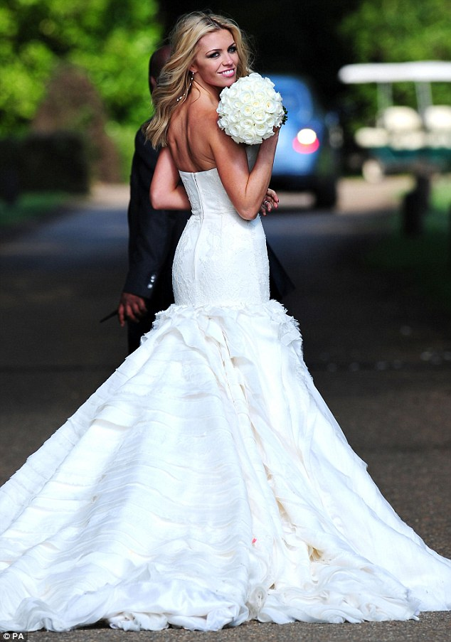Svelte: Clancy's fitted bridal gown showed off her slim figure and tan from her recent Sardinia holiday