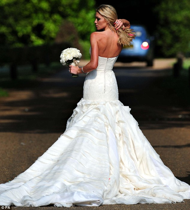 Laidback bride: Clancy for a more relaxed bridal look in the simple gown and loose tousled waves