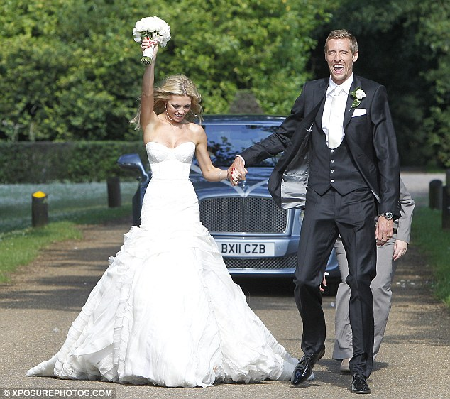 We did it! The couple were in high spirits as they walked hand-in-hand in the sunshine