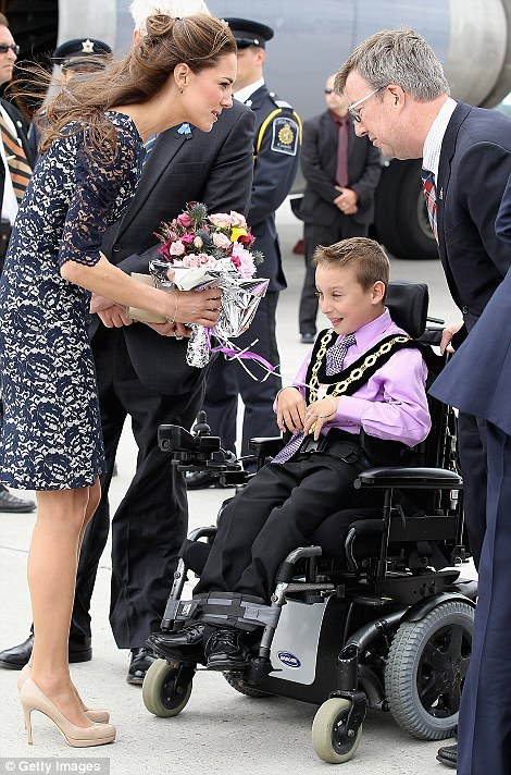 A natural: The Duchess of Cambridge again displayed her affection for children as she spent several minutes talking to Kellen Schlever, who presented her with a beautiful posy of pink roses