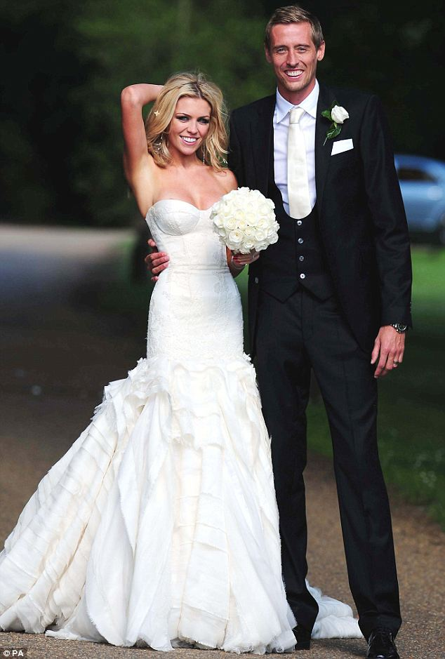 Happy day: Peter Crouch and Abbey Clancy are all smiles as they pose for the cameras