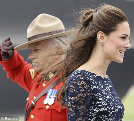 Attention: A Mountie salutes the Duchess of Cambridge, who smiles in return