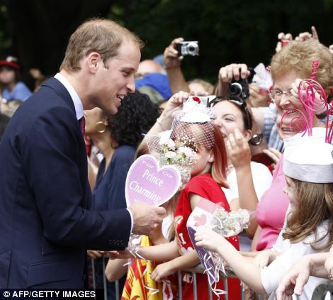 Britain's Prince William greets spectators during an official welcoming ceremony at Rideau Hall