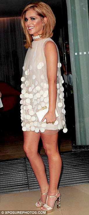 Well-heeled: Cheryl teamed her dress with a pair of champagne-coloured high heel sandals