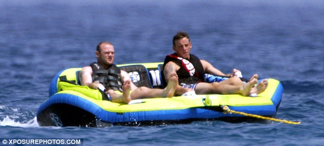 Water sports: Wayne and Coleen's younger brother had fun in the water by being pulled across the sea on an inflatable raft