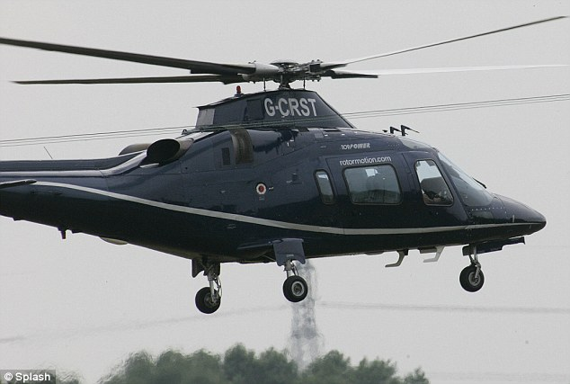 Up, up and away: The helicopter takes the newlyweds to an airport, whey they are expected to fly to their mystery honeymoon destination